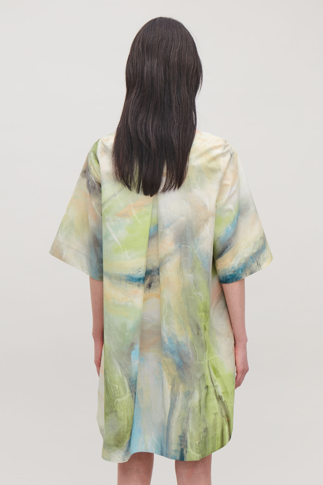 Model side image of Cos brush-stroke printed dress in green