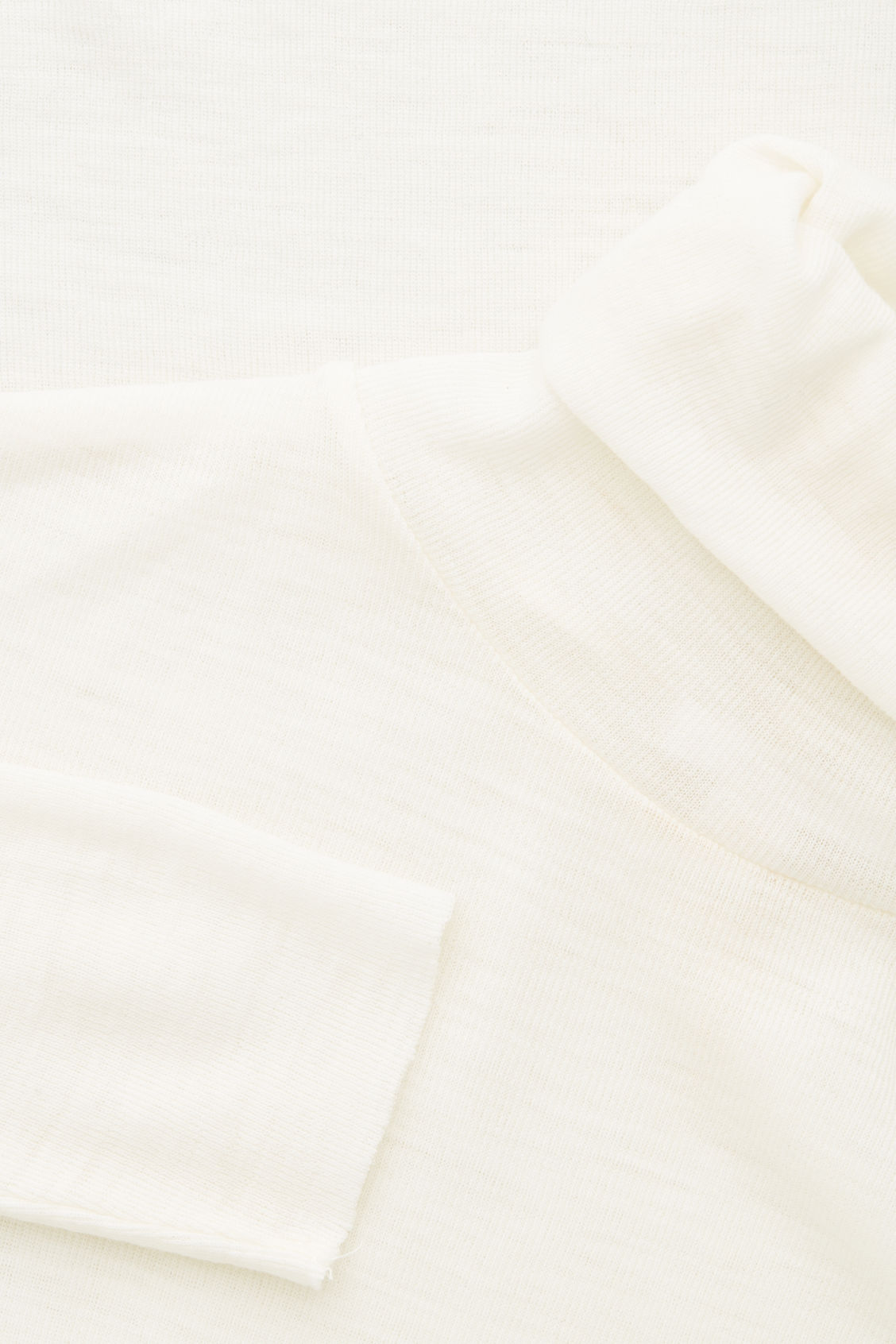 Side image of Cos fine roll-neck wool top in white