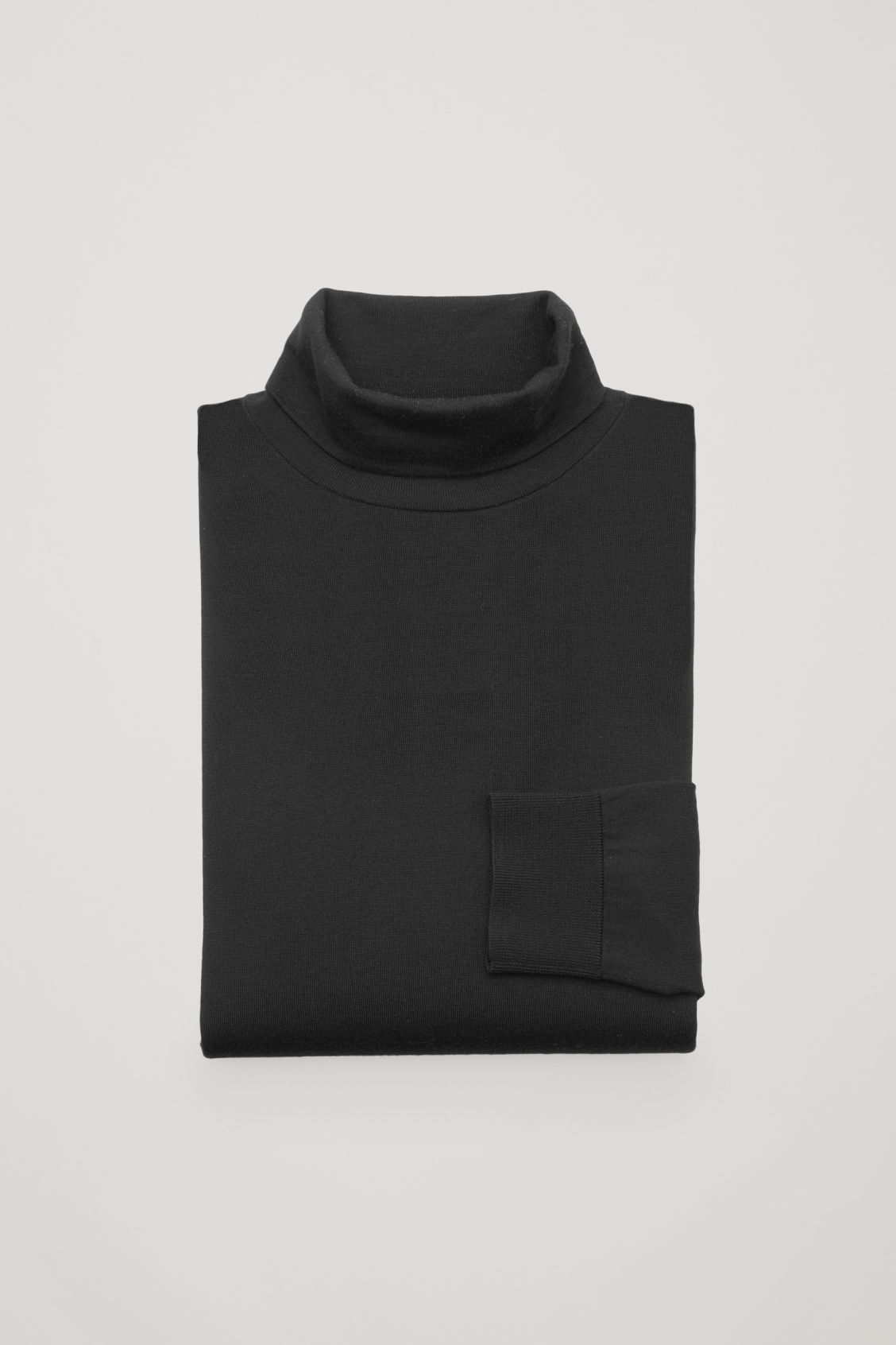 Side image of Cos merino roll-neck jumper in black