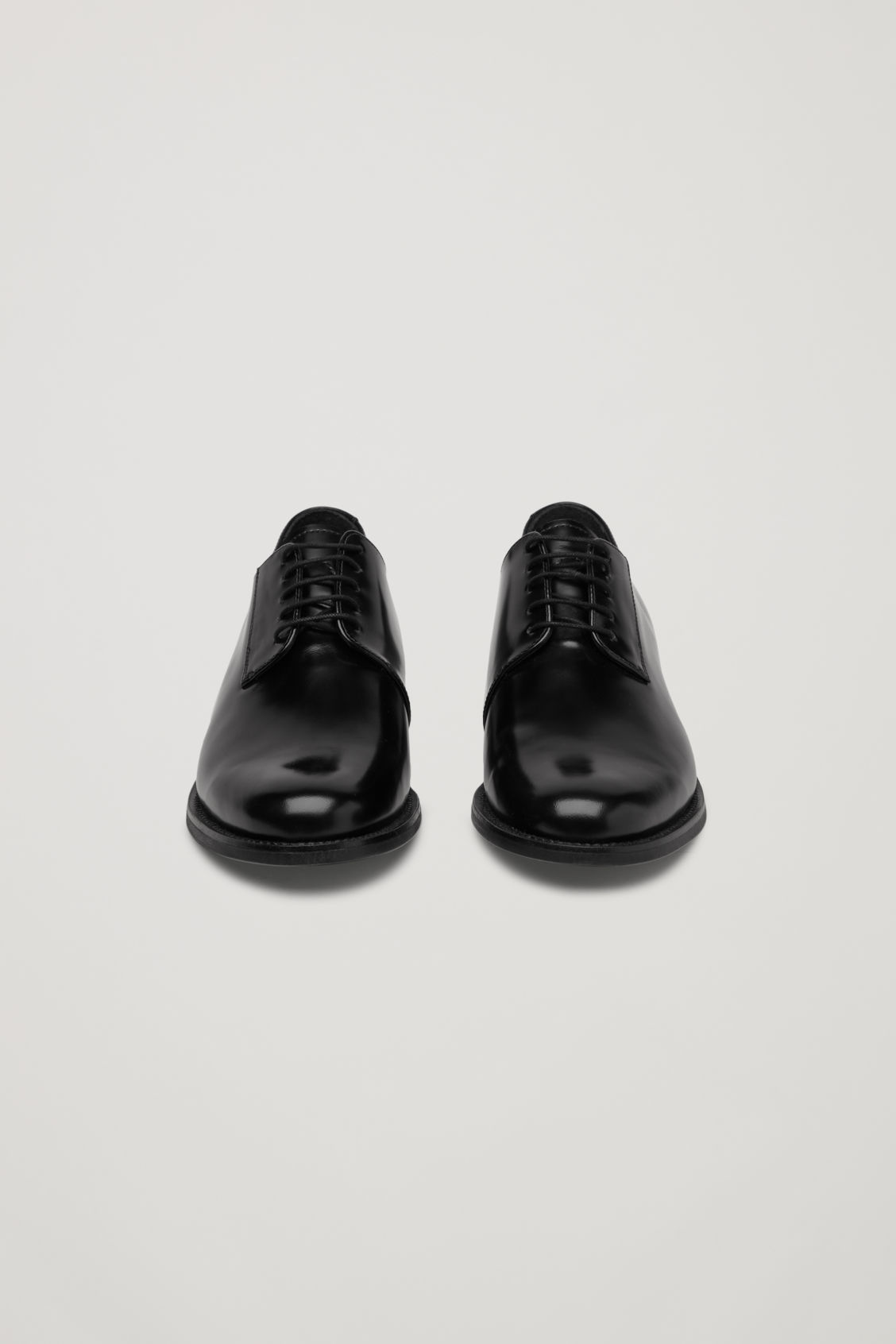 Side image of Cos point-toe leather oxford shoes in black