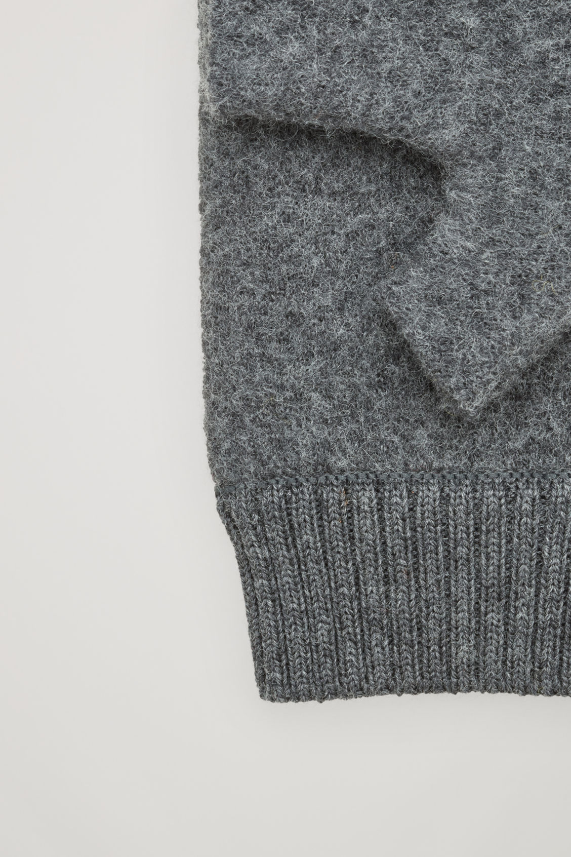 Side image of Cos merino fingerless gloves in grey