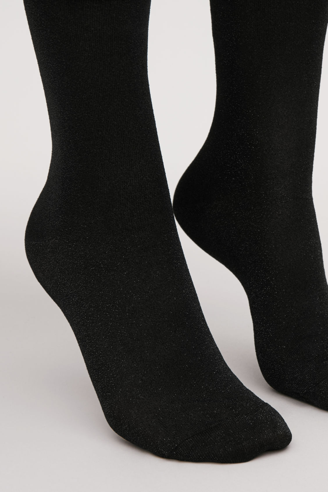 Side image of Cos metallic socks in black