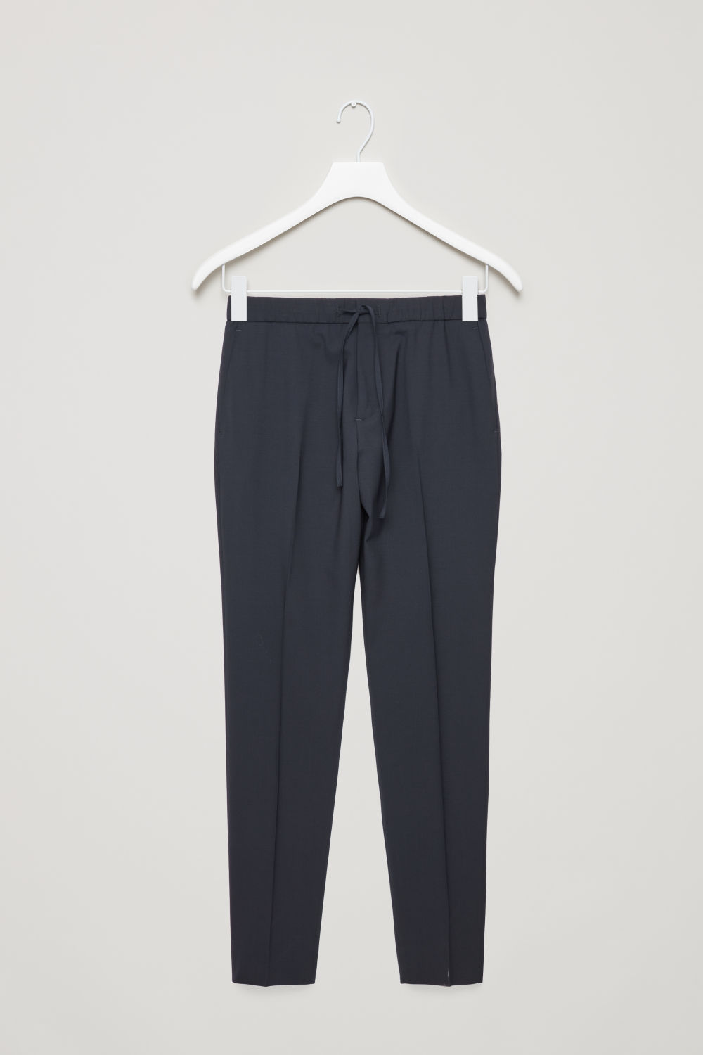 Front image of Cos drawstring tailored trousers in blue