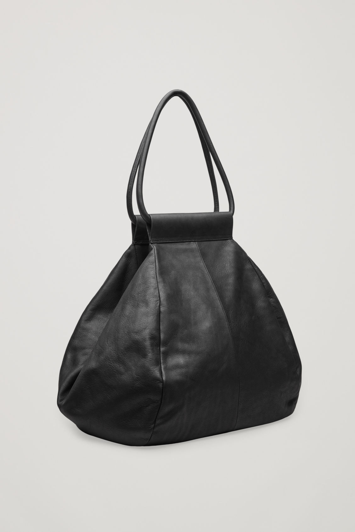 Side image of Cos folded leather tote bag in black