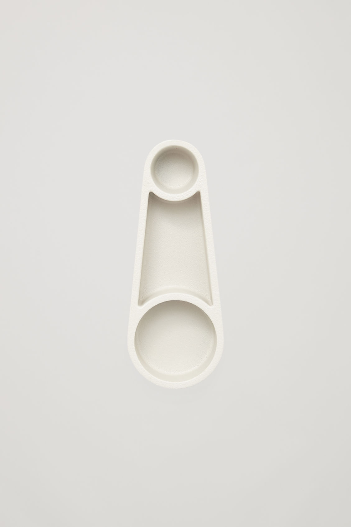 Front image of Cos hay kutter candle holder in white