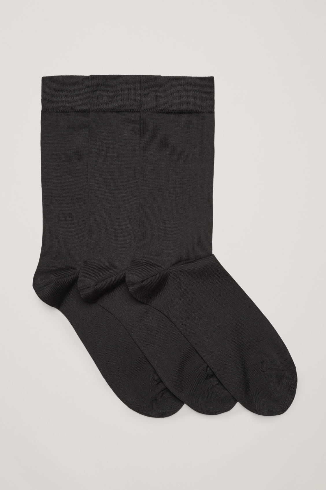 Front image of Cos three pairs of socks in black