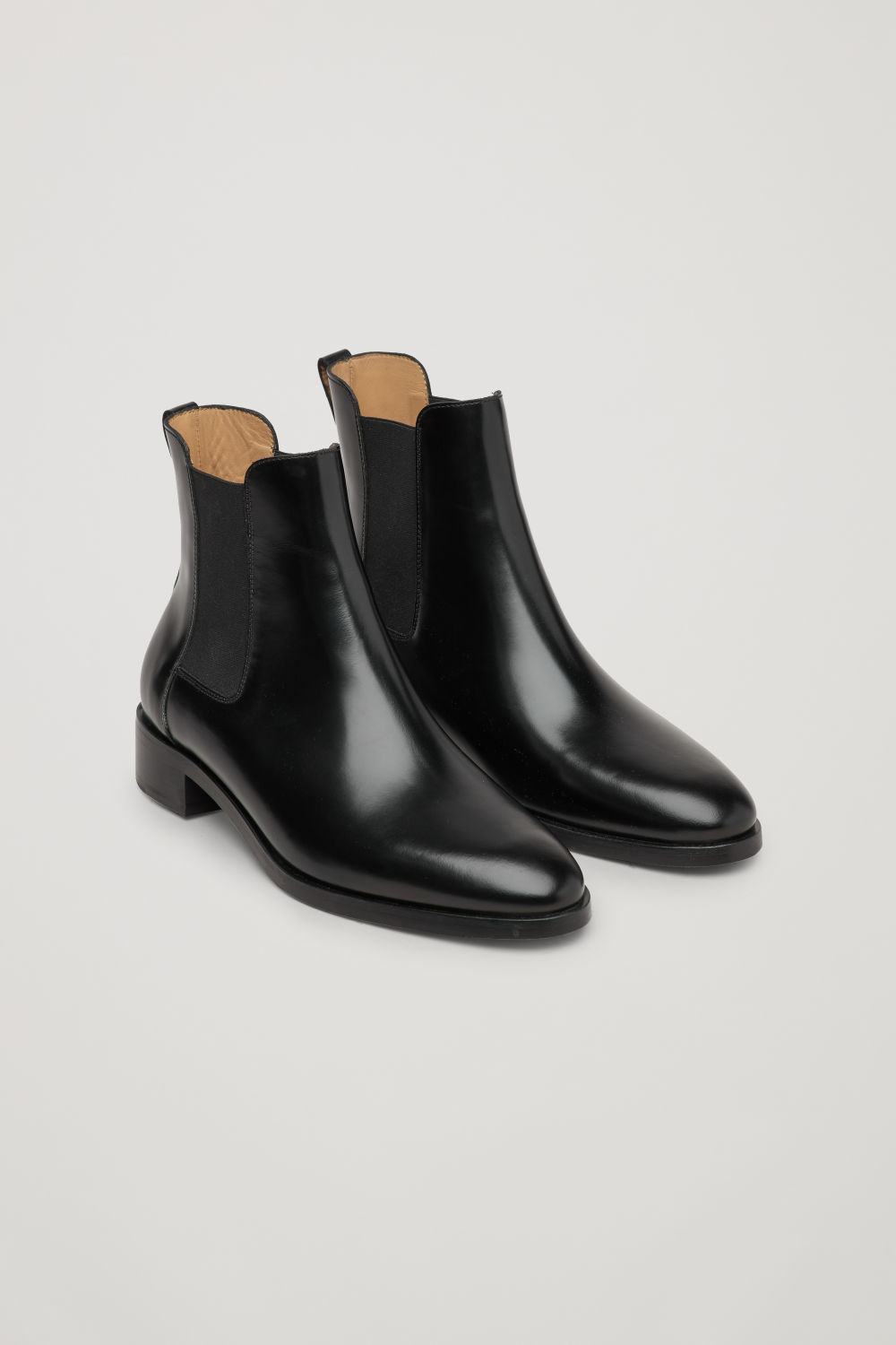 Front image of Cos chelsea boots in black