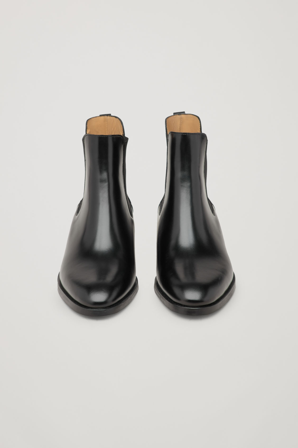 Side image of Cos chelsea boots in black