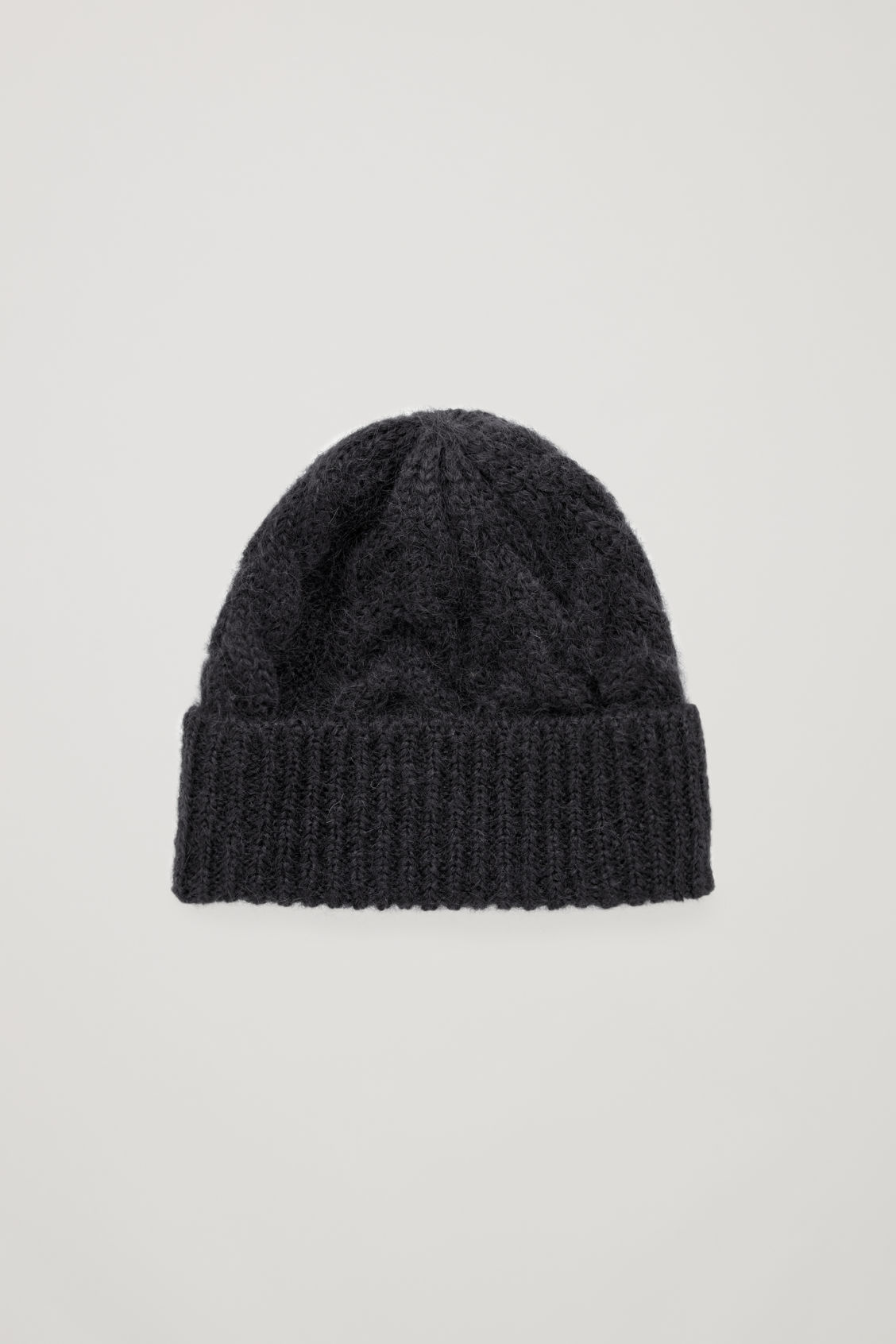 Front image of Cos cable-knit hat in black