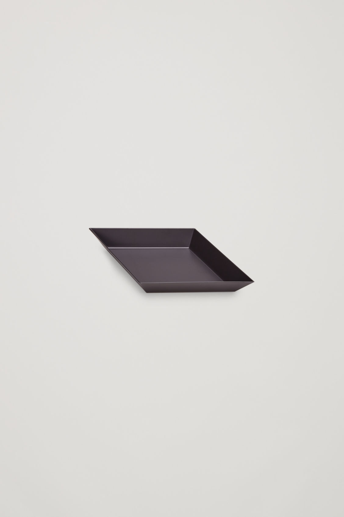 Side image of Cos hay kaleido x-small metal tray in black