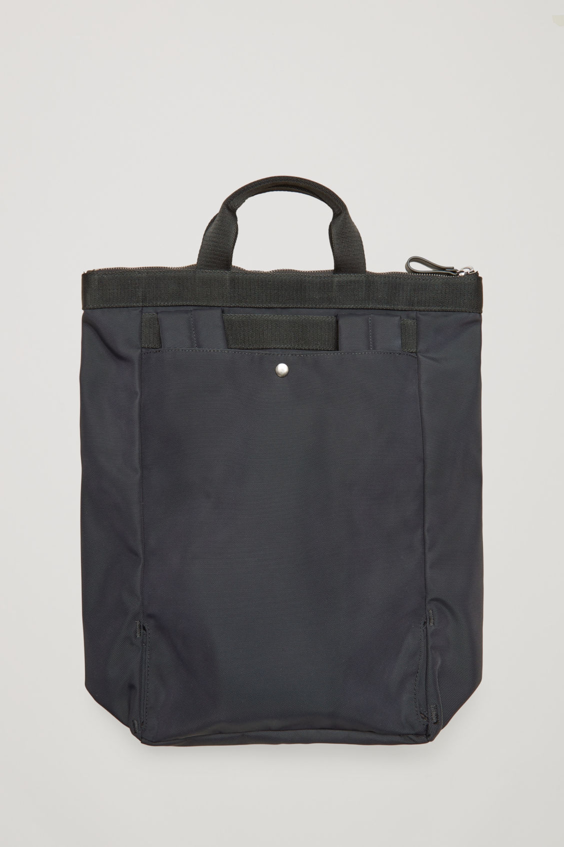 Side image of Cos tote backpack in black