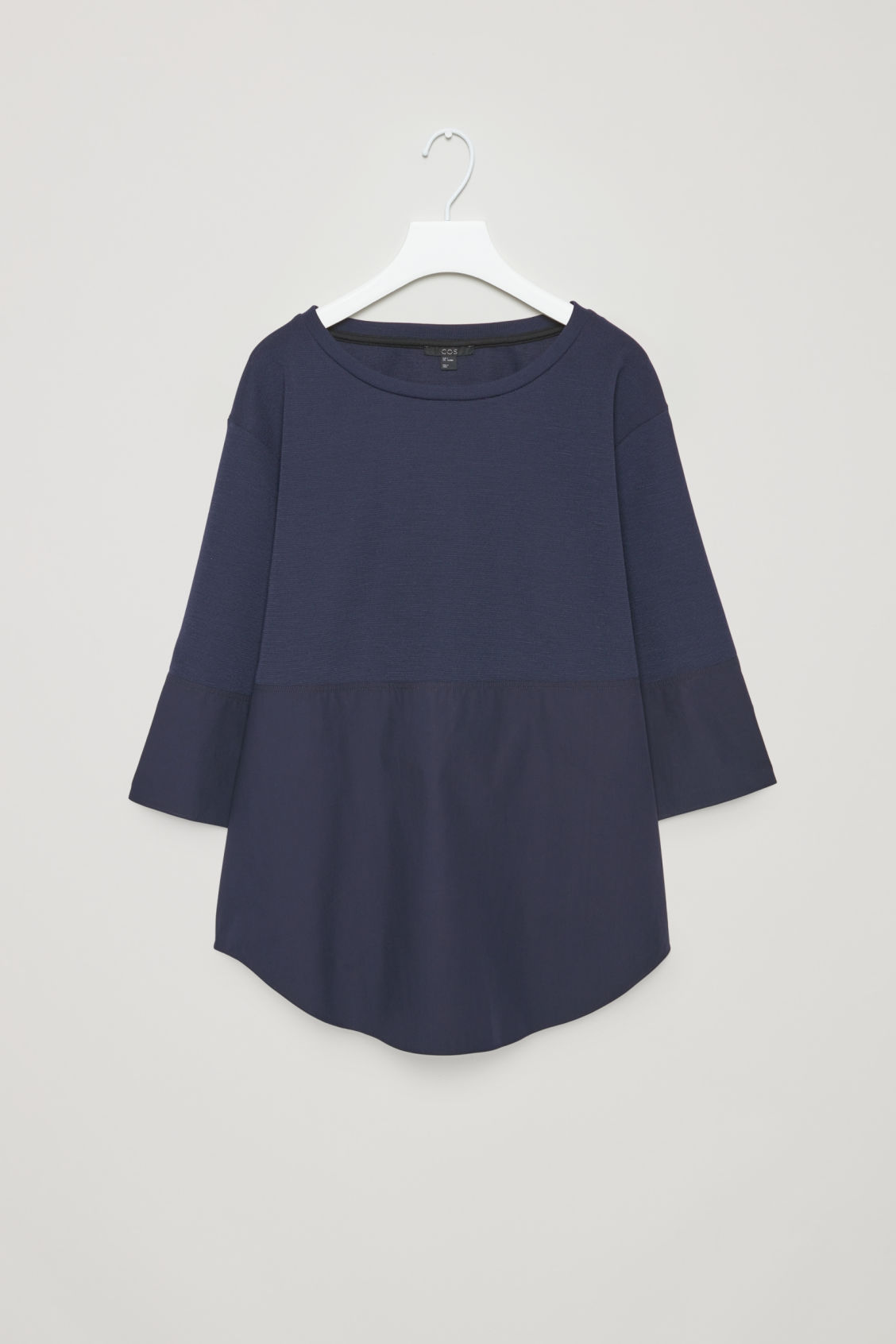 Front image of Cos jumper with shirt hem in blue