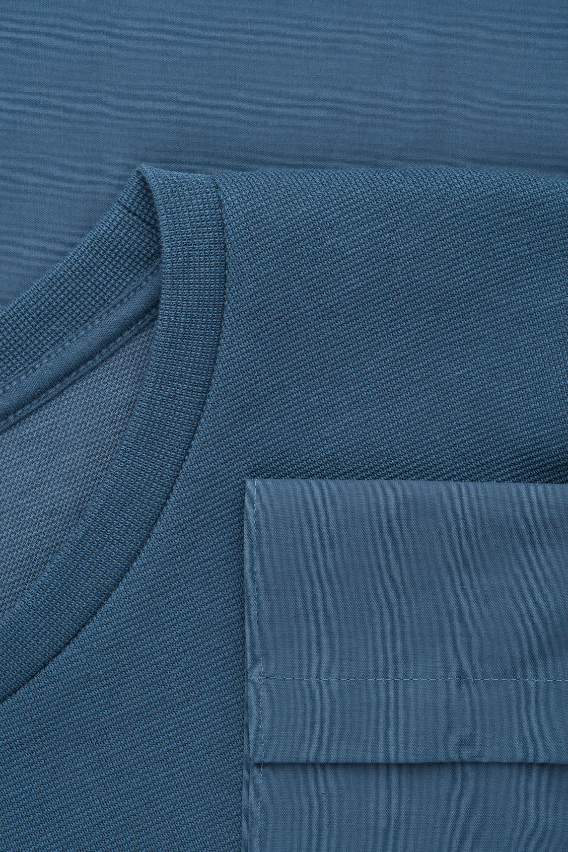 Side image of Cos sweatshirt with shirt hem in blue