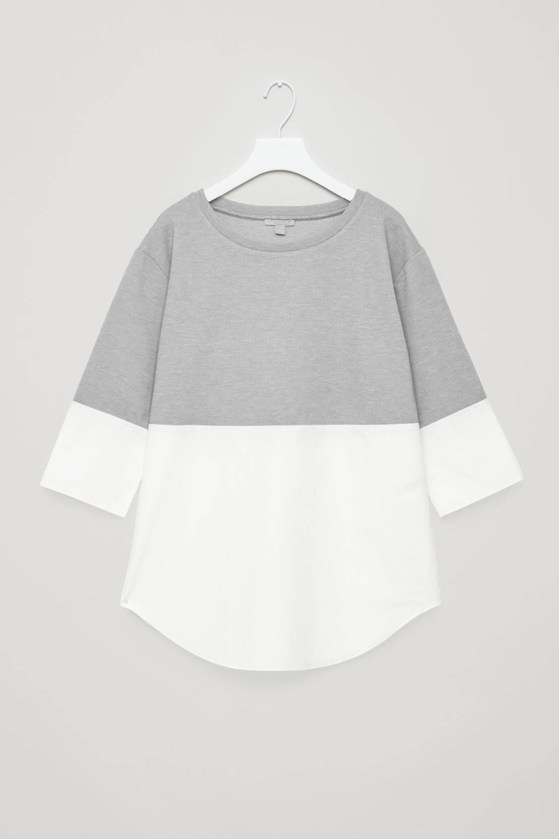 Front image of Cos jumper with shirt hem in grey