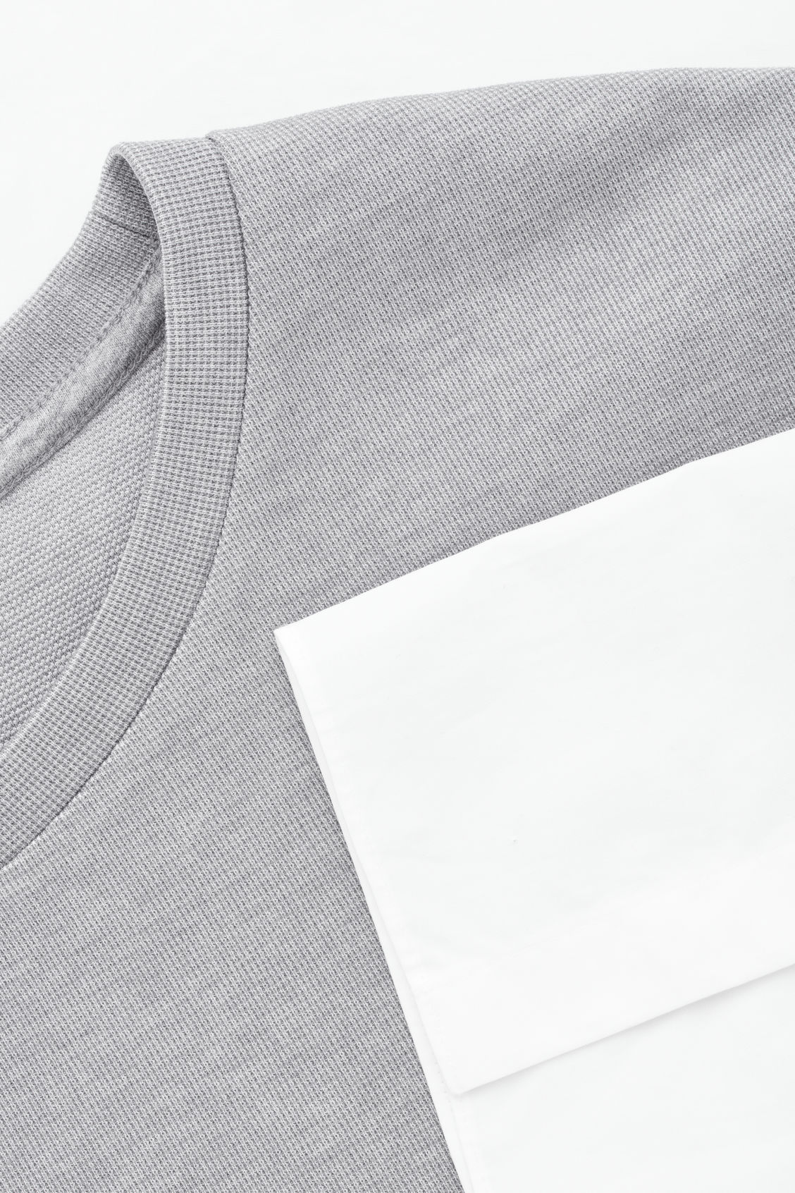 Side image of Cos jumper with shirt hem in grey