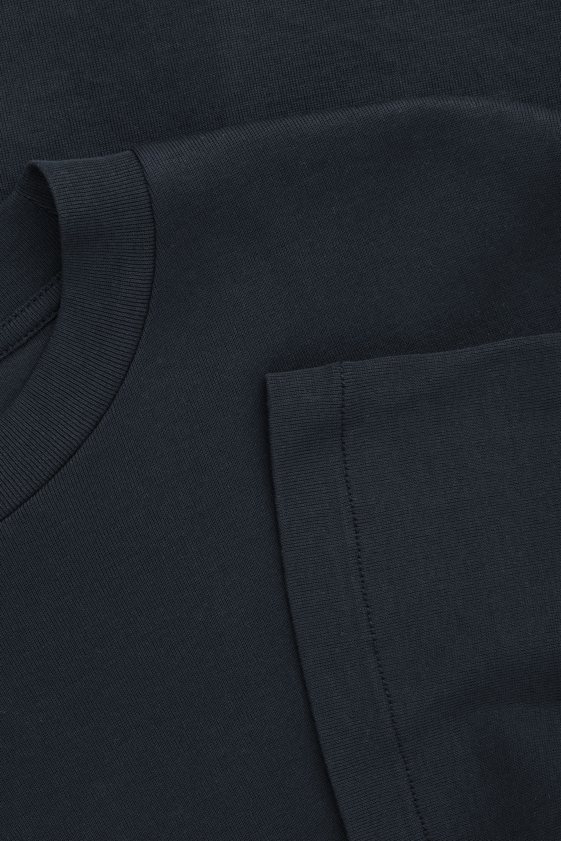 Side image of Cos t-shirt with mock neck in blue