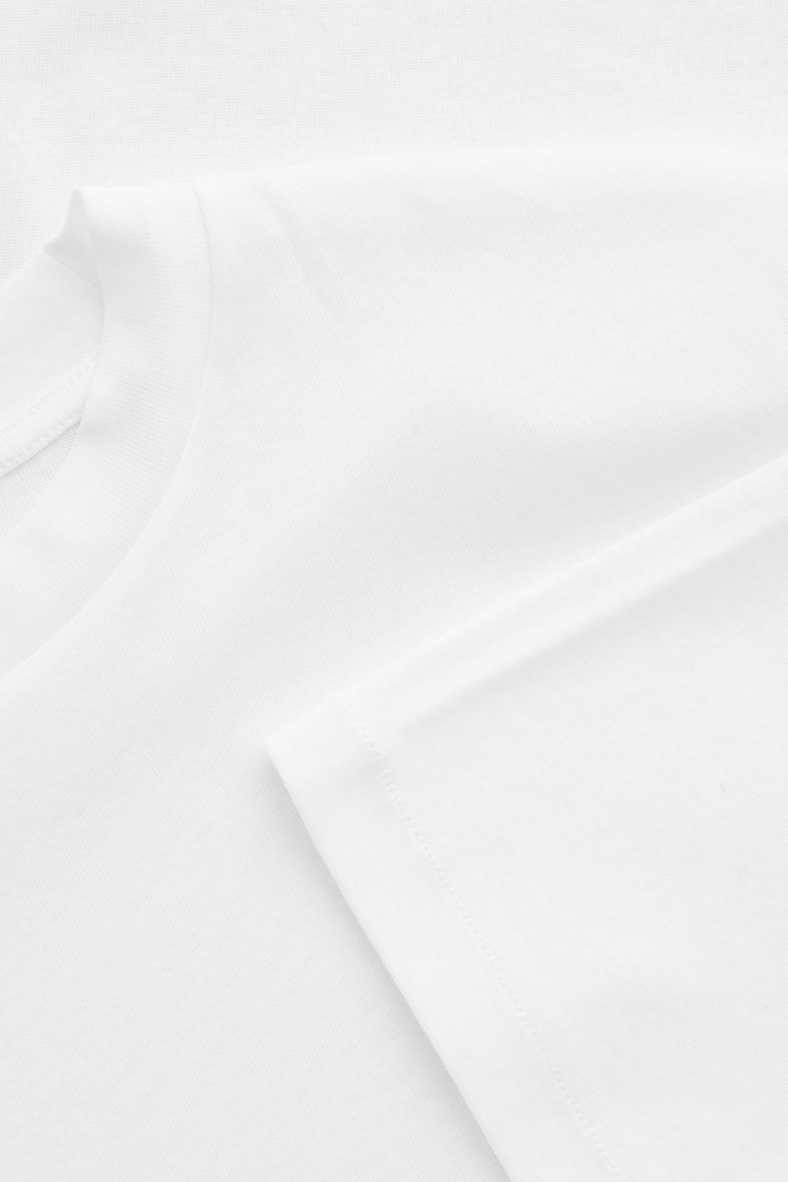 Side image of Cos t-shirt with mock neck in white