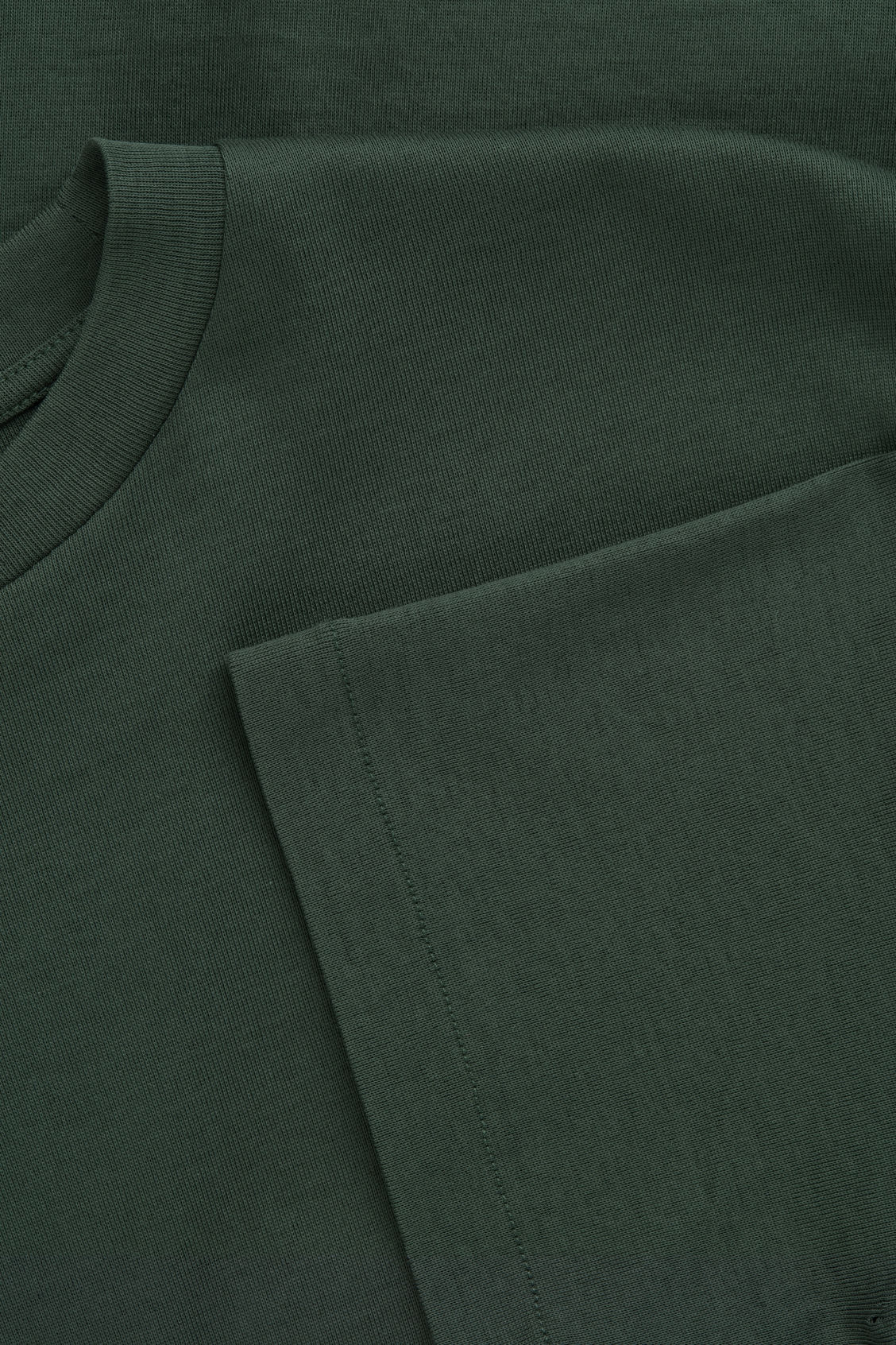 Side image of Cos t-shirt with mock neck in green