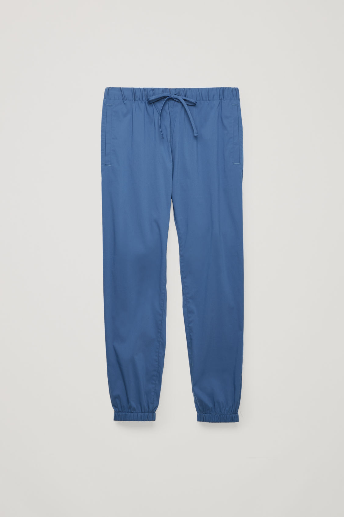 Front image of Cos elastic-waist cotton trousers in blue