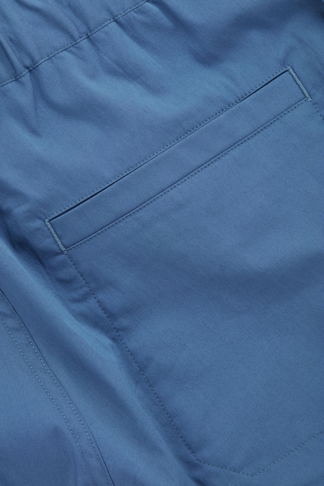 Side image of Cos elastic-waist cotton trousers in blue
