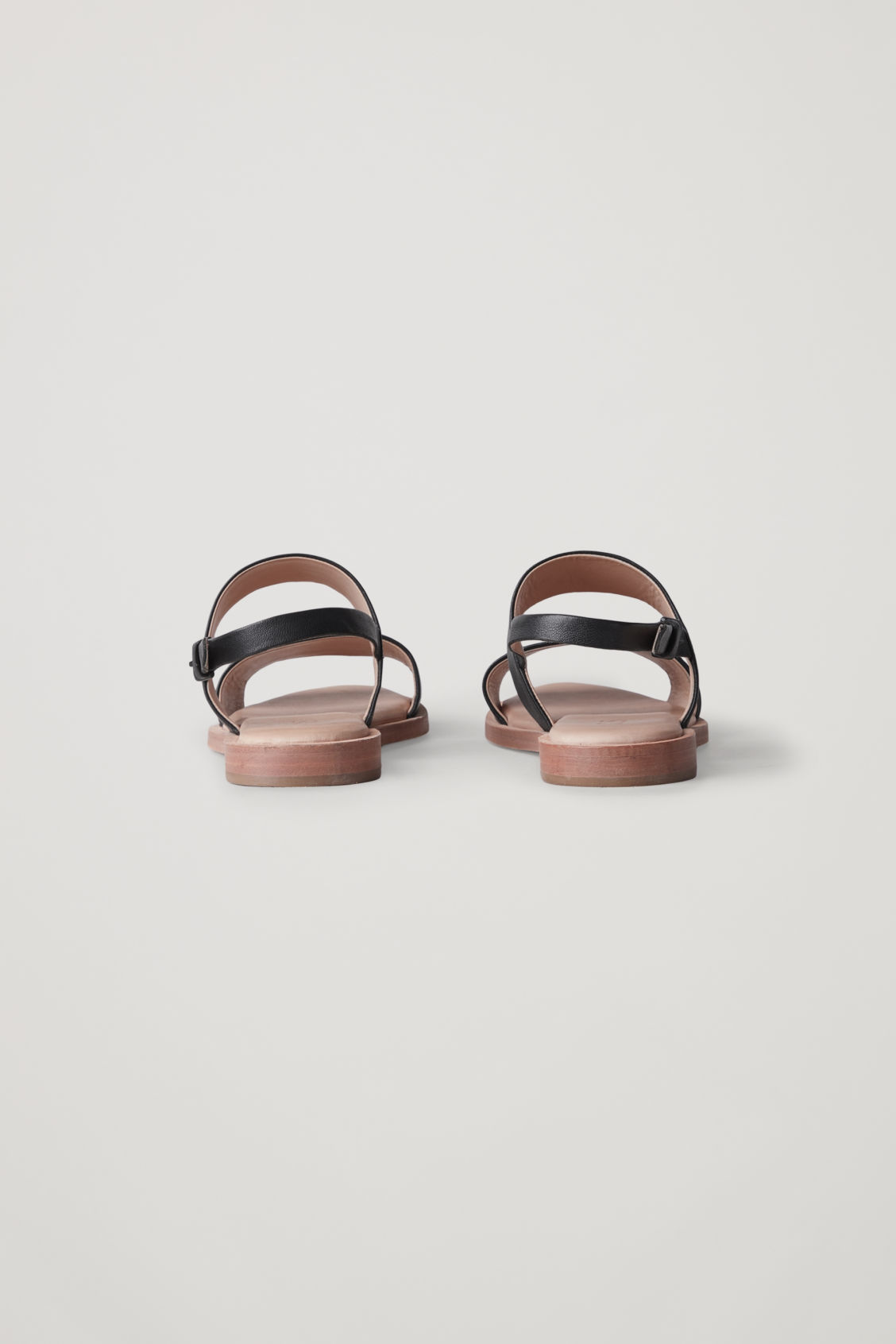 Side image of Cos leather strap sandals  in black