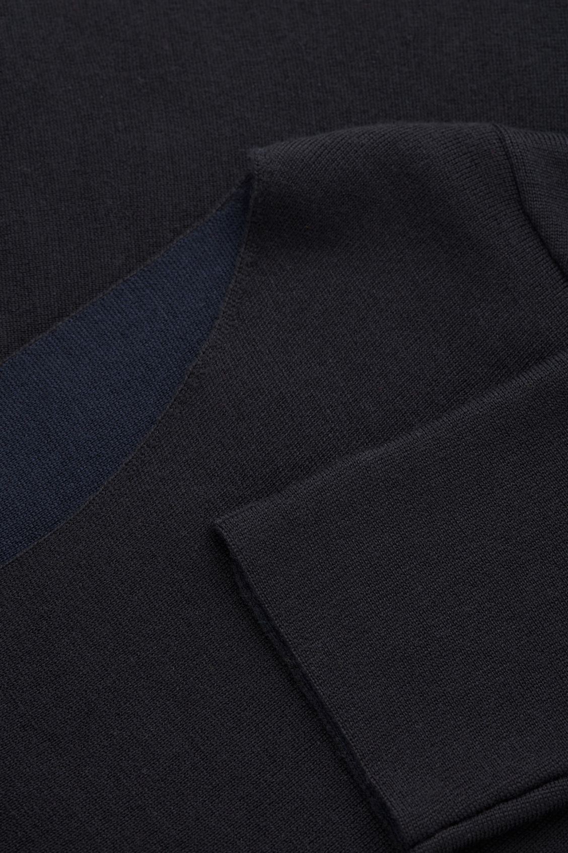 Side image of Cos a-line merino jumper in black