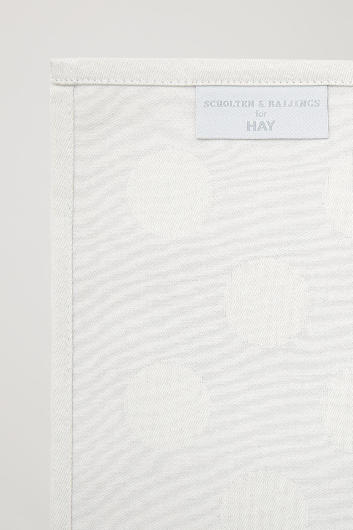 Side image of Cos hay dot place mat set of 4 in grey