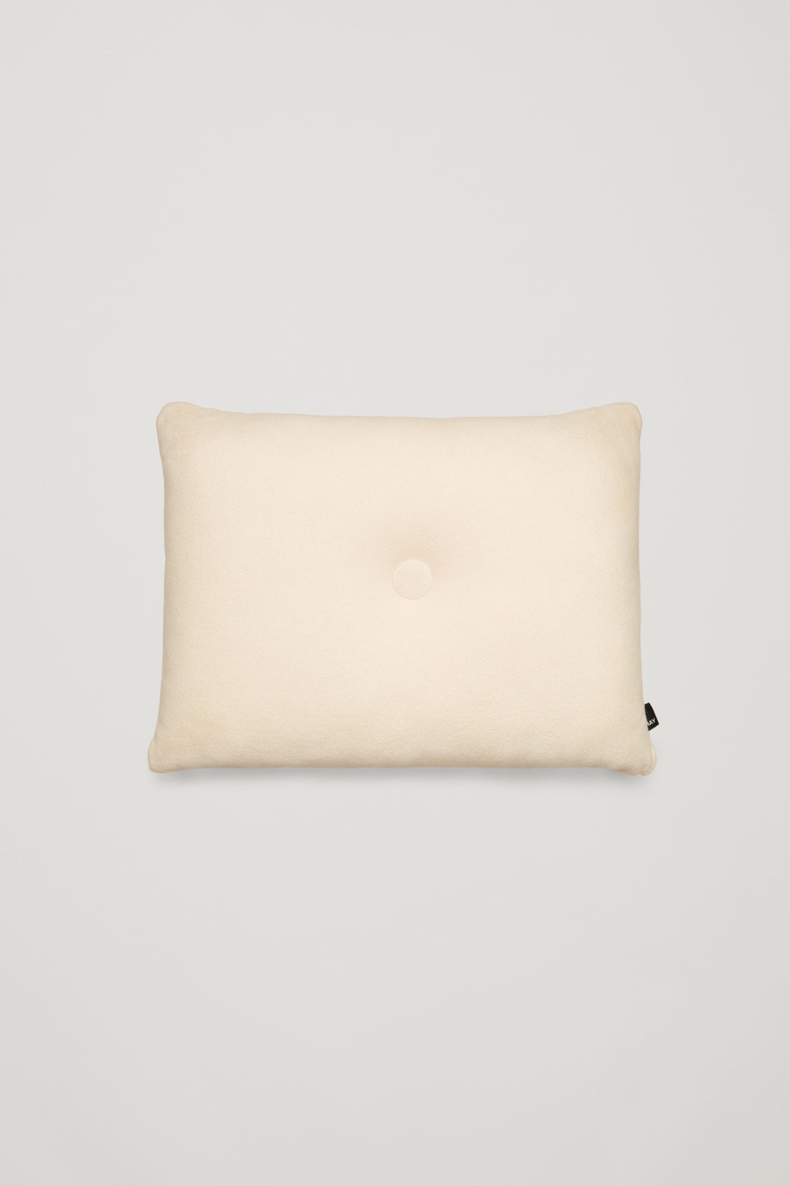 Side image of Cos hay dot cushion in white