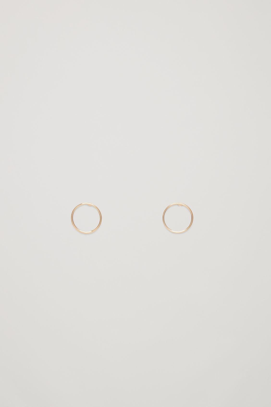 Front image of Cos circular stud earrings in gold