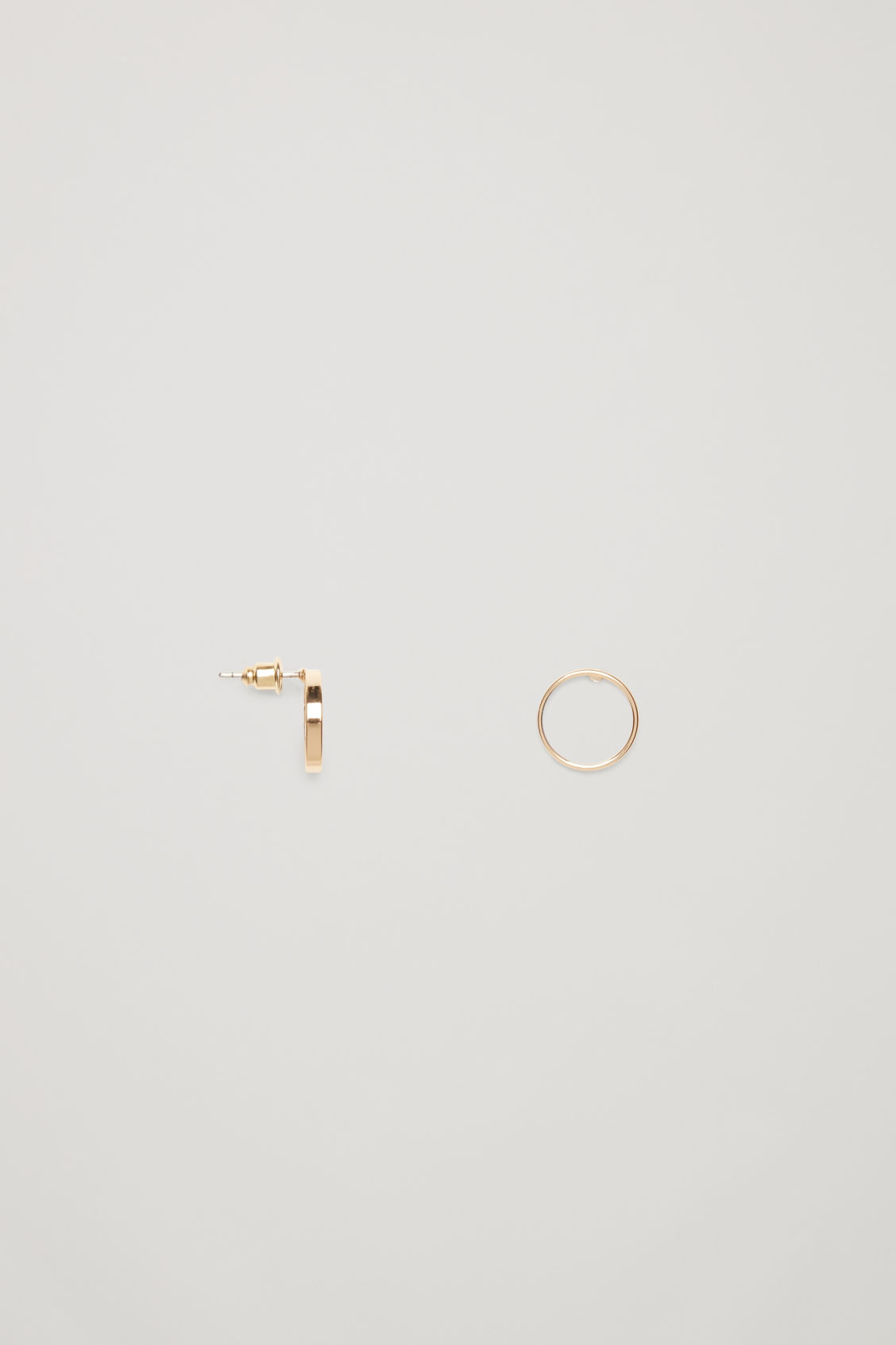 Side image of Cos circular stud earrings in gold