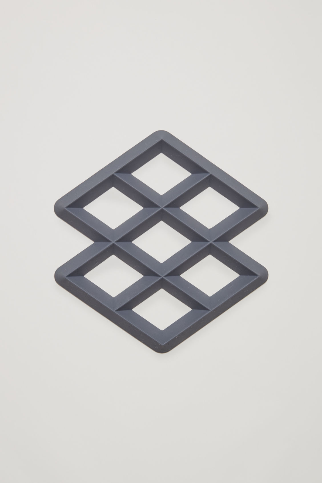 Front image of Cos hay rhom trivet in grey