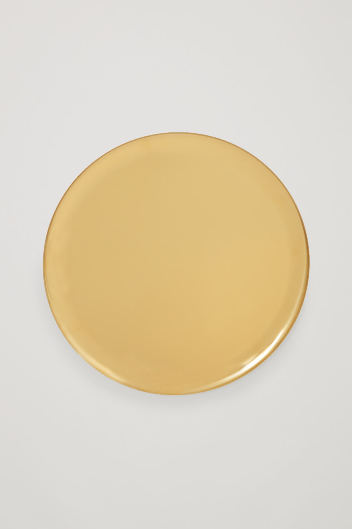 Side image of Cos hay serving tray  in gold