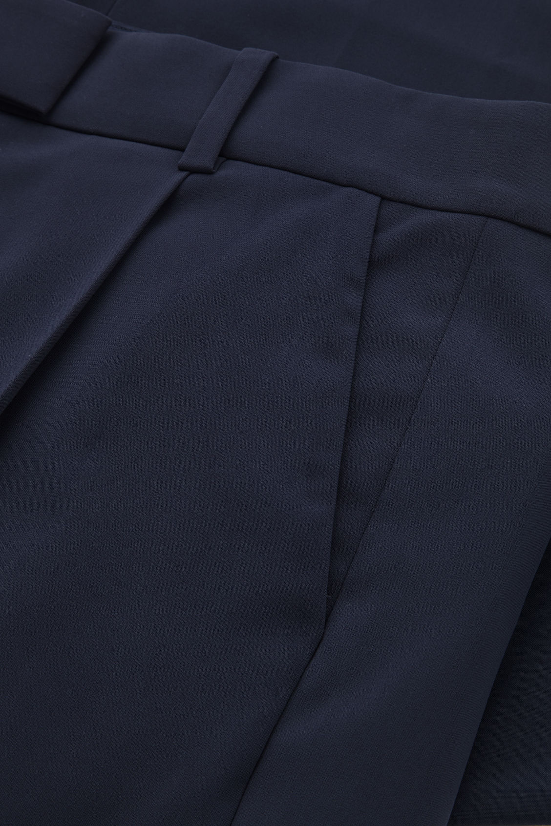 Side image of Cos tailored pleat trousers in blue