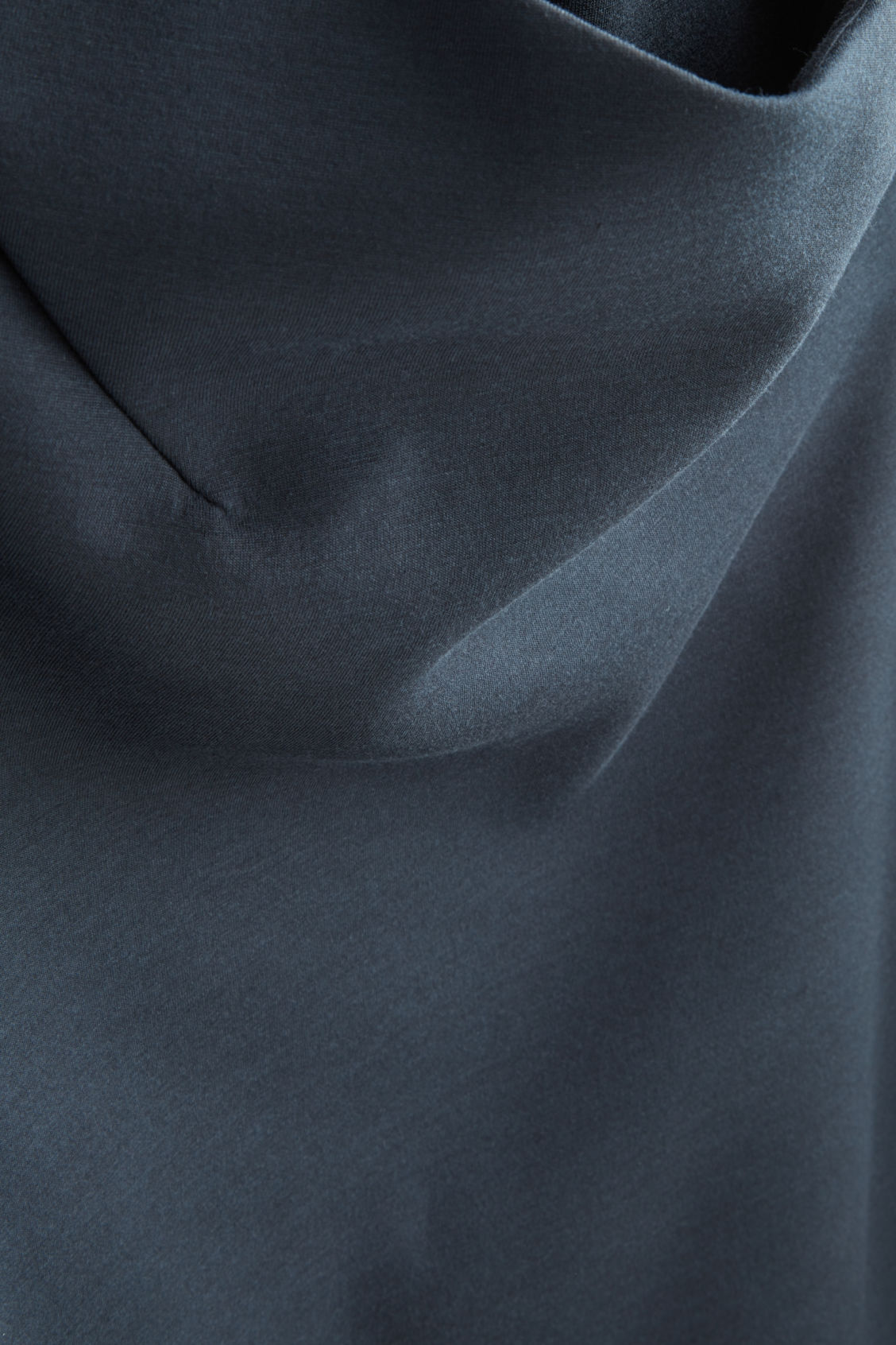 Side image of Cos top with draped neck in blue