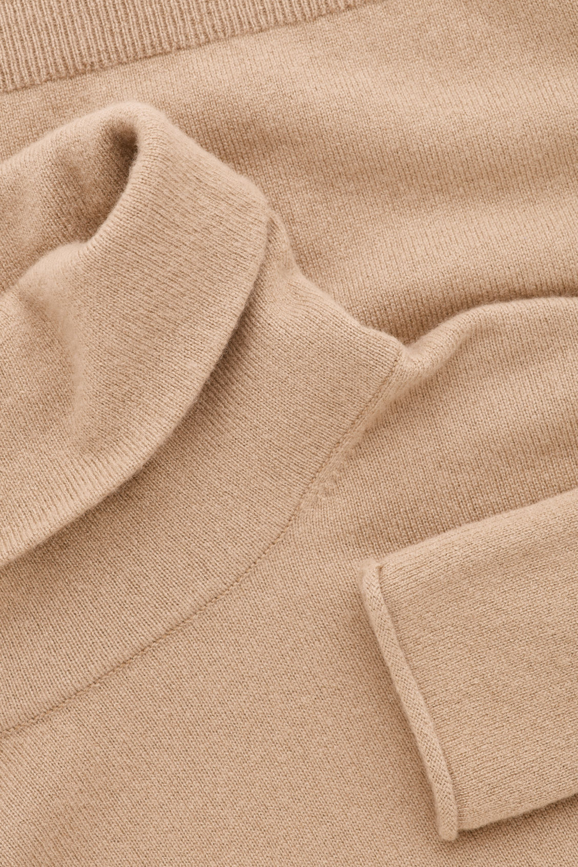 Side image of Cos roll-neck cashmere jumper in beige