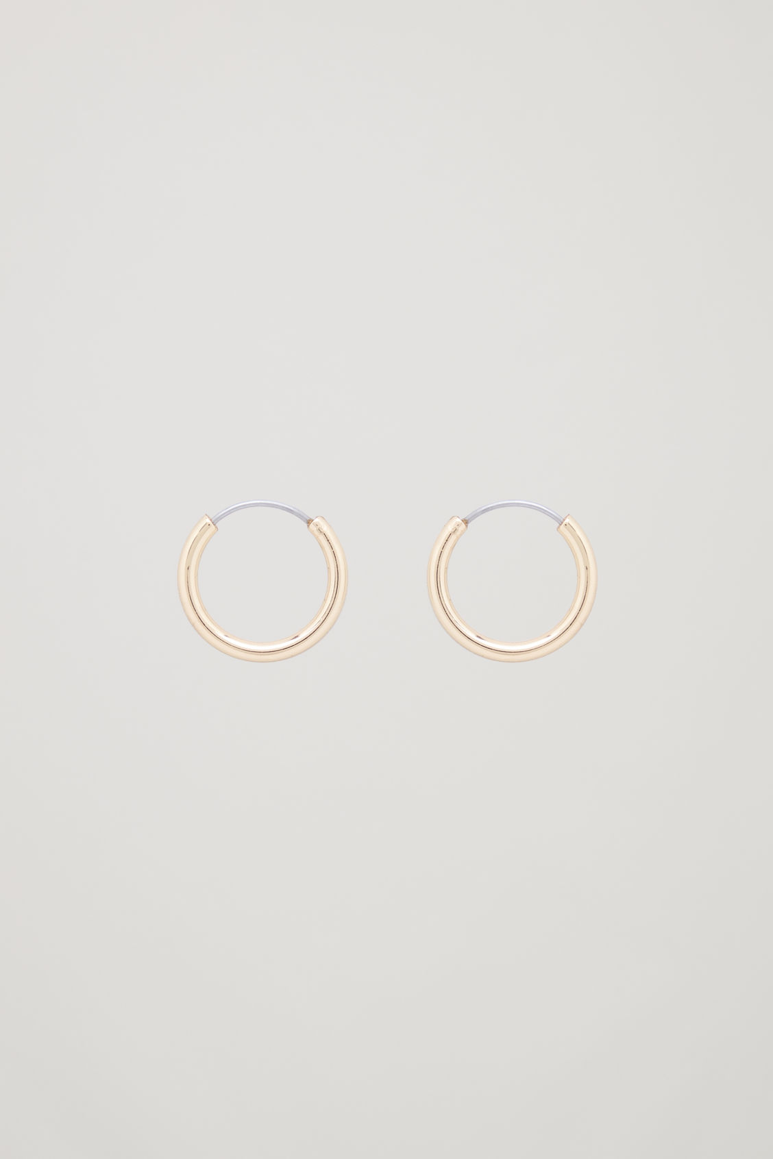 Front image of Cos small hoop earrings in gold