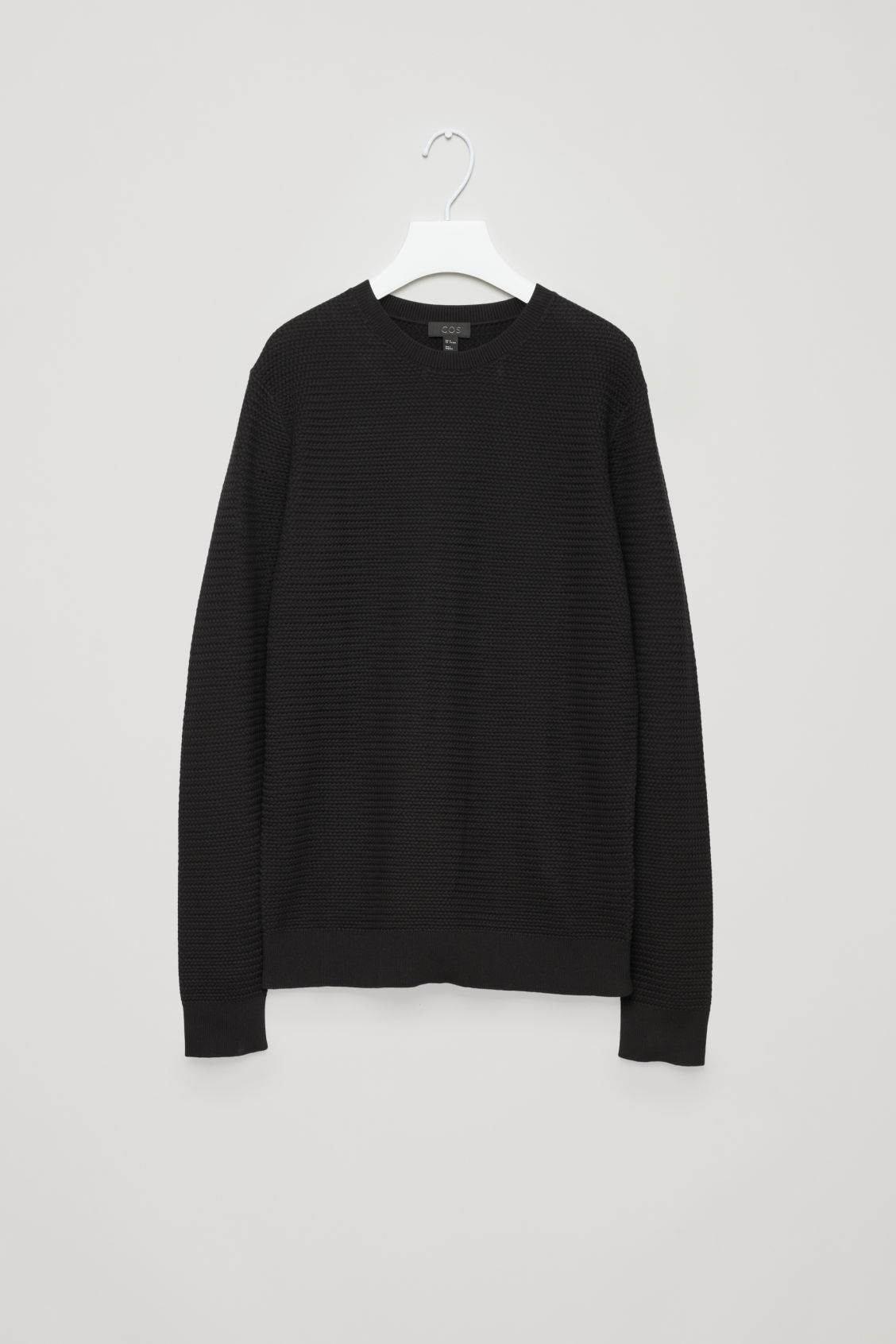 Front image of Cos structured knit jumper in black