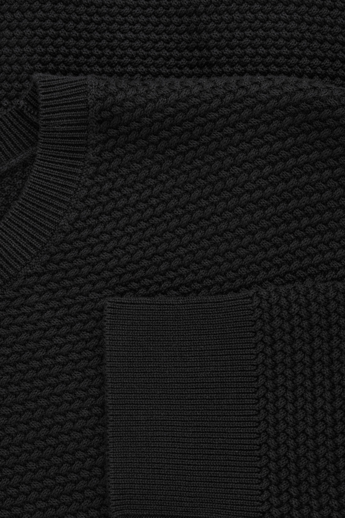 Side image of Cos structured knit jumper in black
