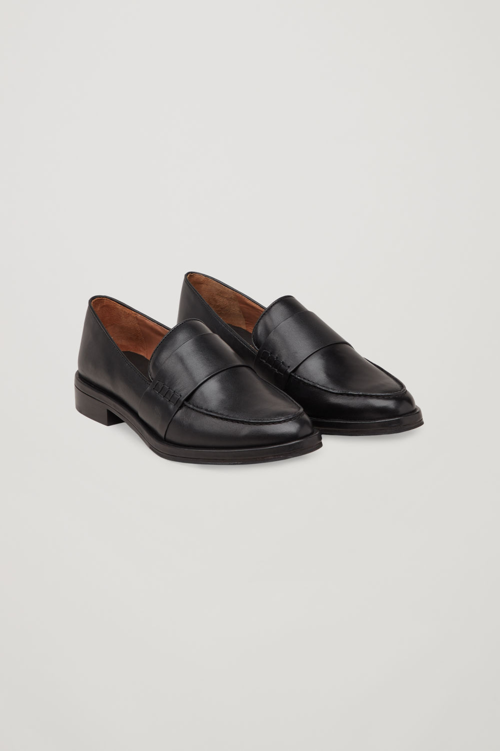Front image of Cos leather loafers in black