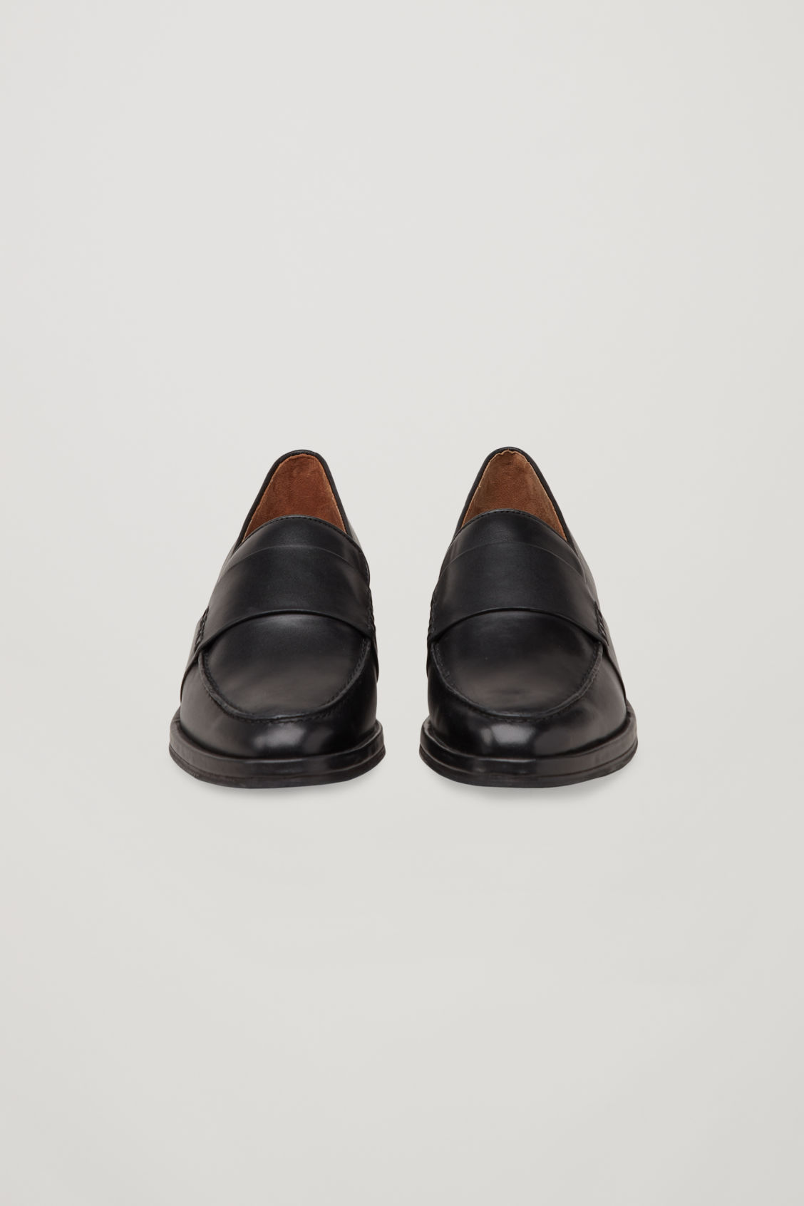 Side image of Cos leather loafers in black