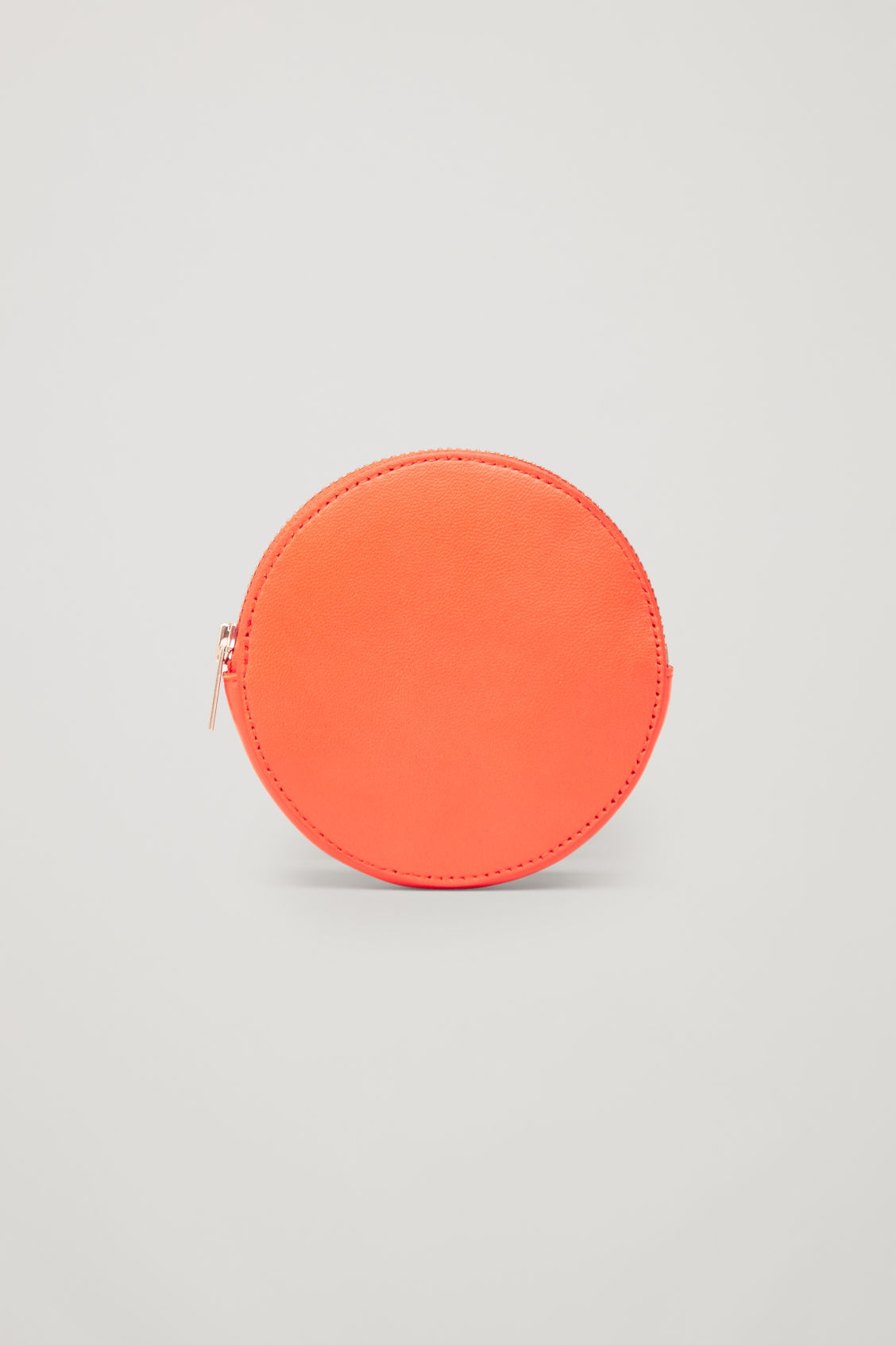 Front image of Cos round leather purse in orange