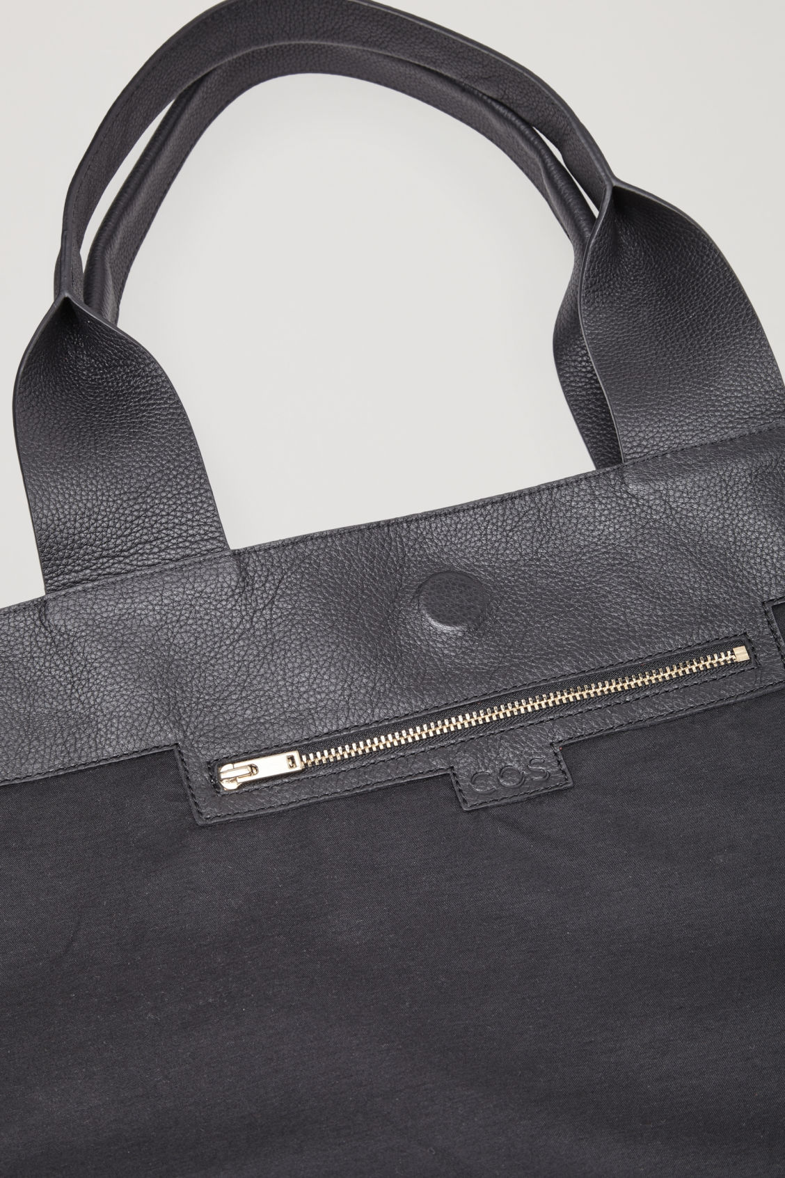 Side image of Cos large grained leather bag in black