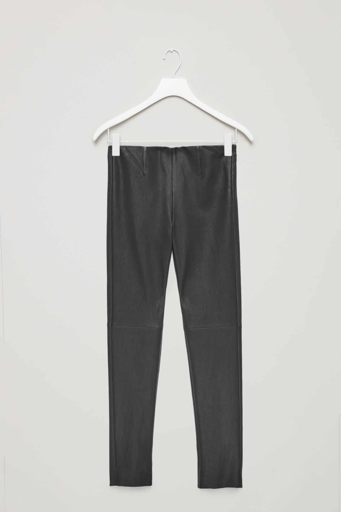 Front image of Cos slim-fit leather trousers in black
