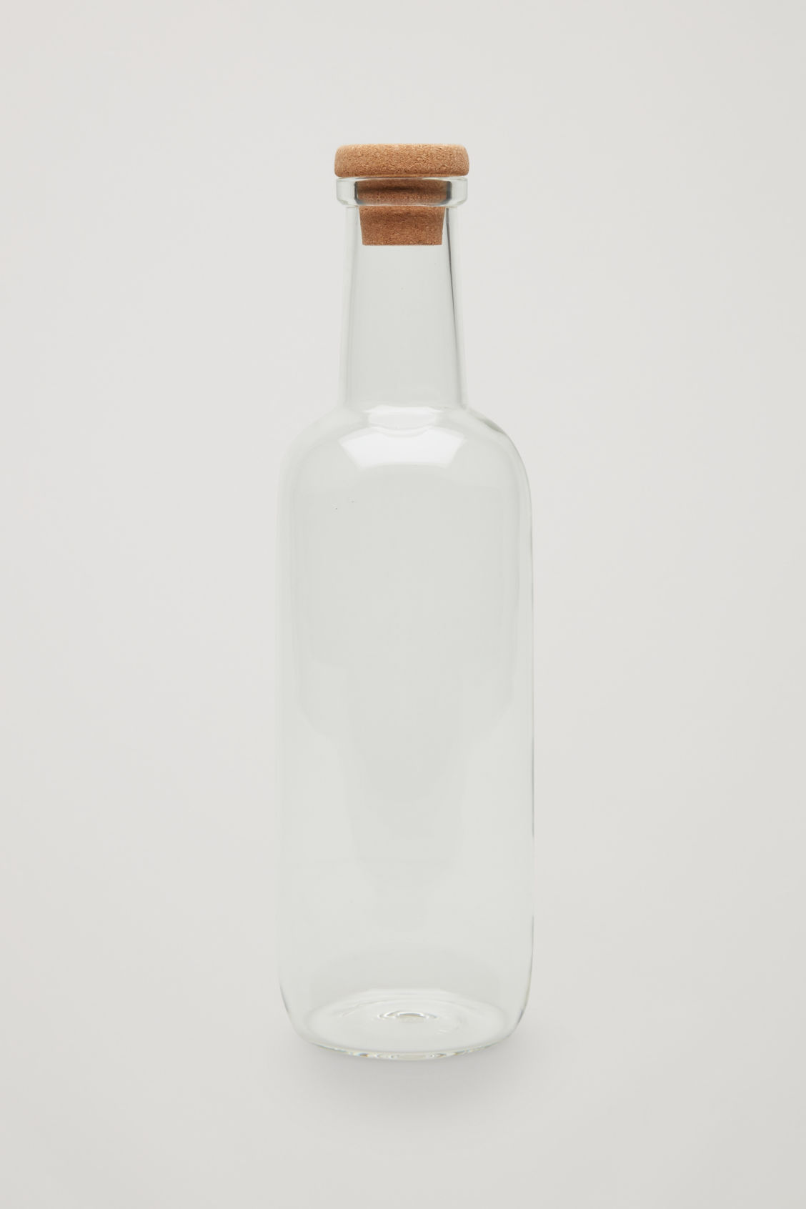 Front image of Cos hay small glass bottle in white