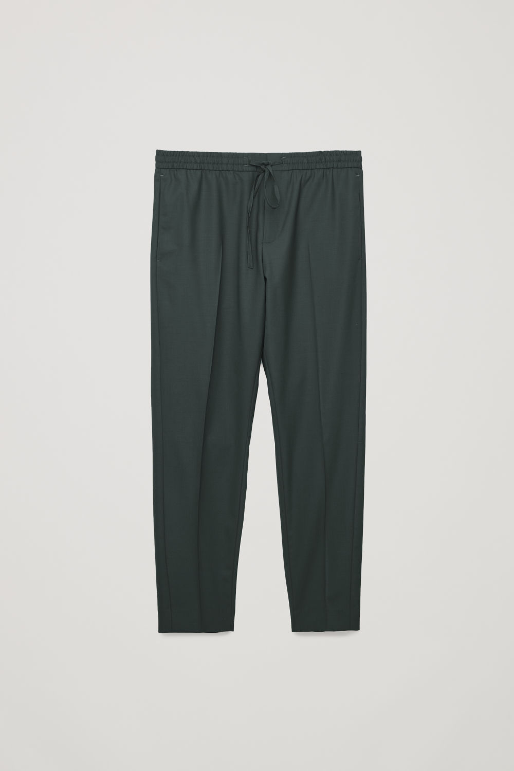 Front image of Cos slim-fit trousers with elastic waist in green
