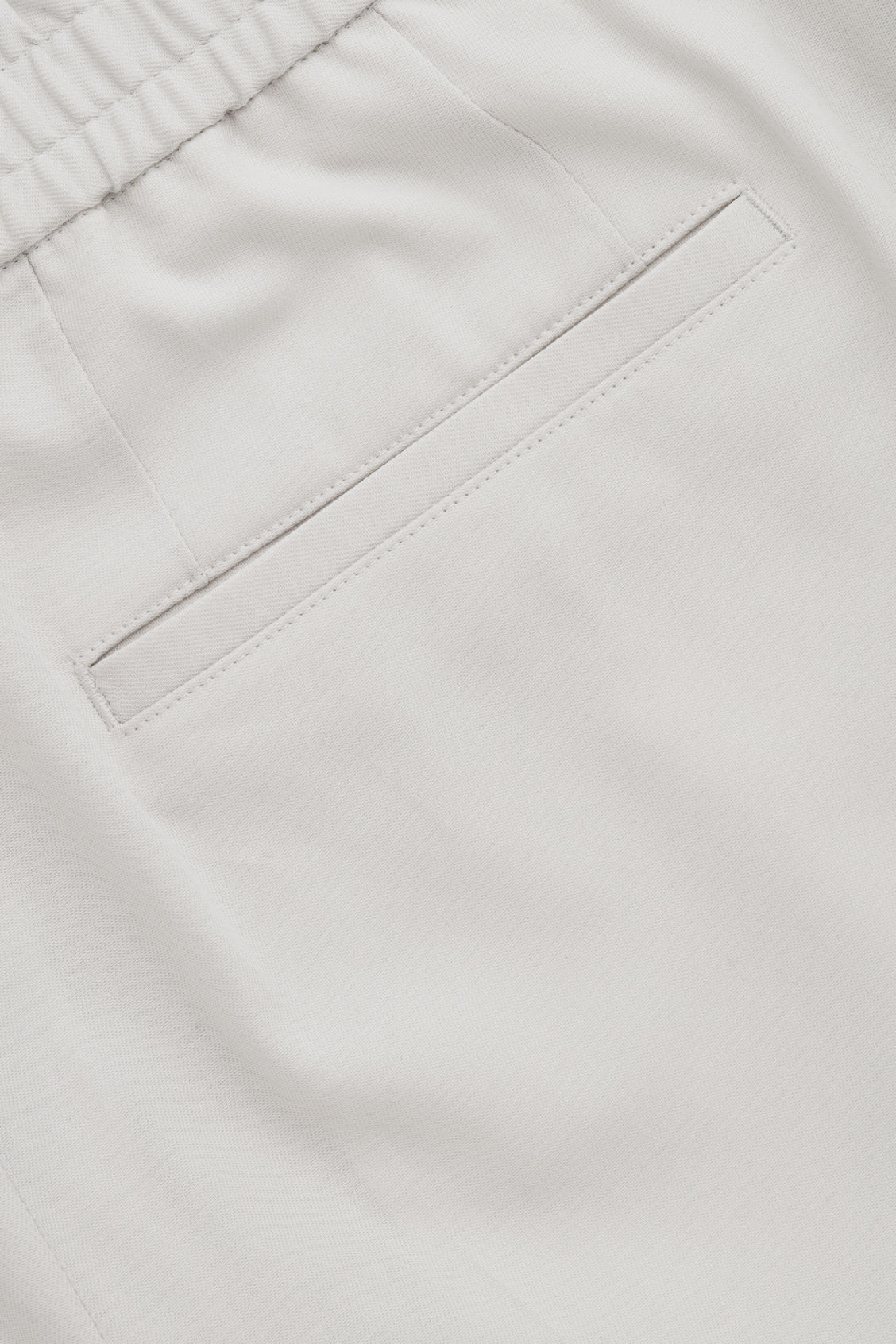 Side image of Cos relaxed turn-up trousers in beige