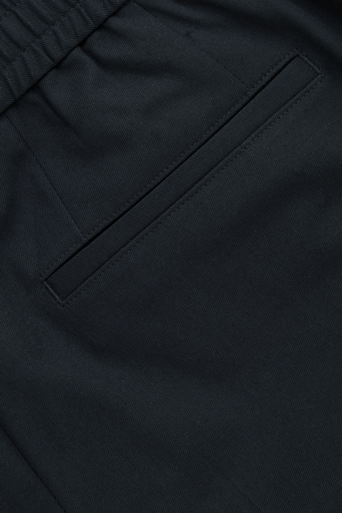 Side image of Cos relaxed turn-up trousers in blue