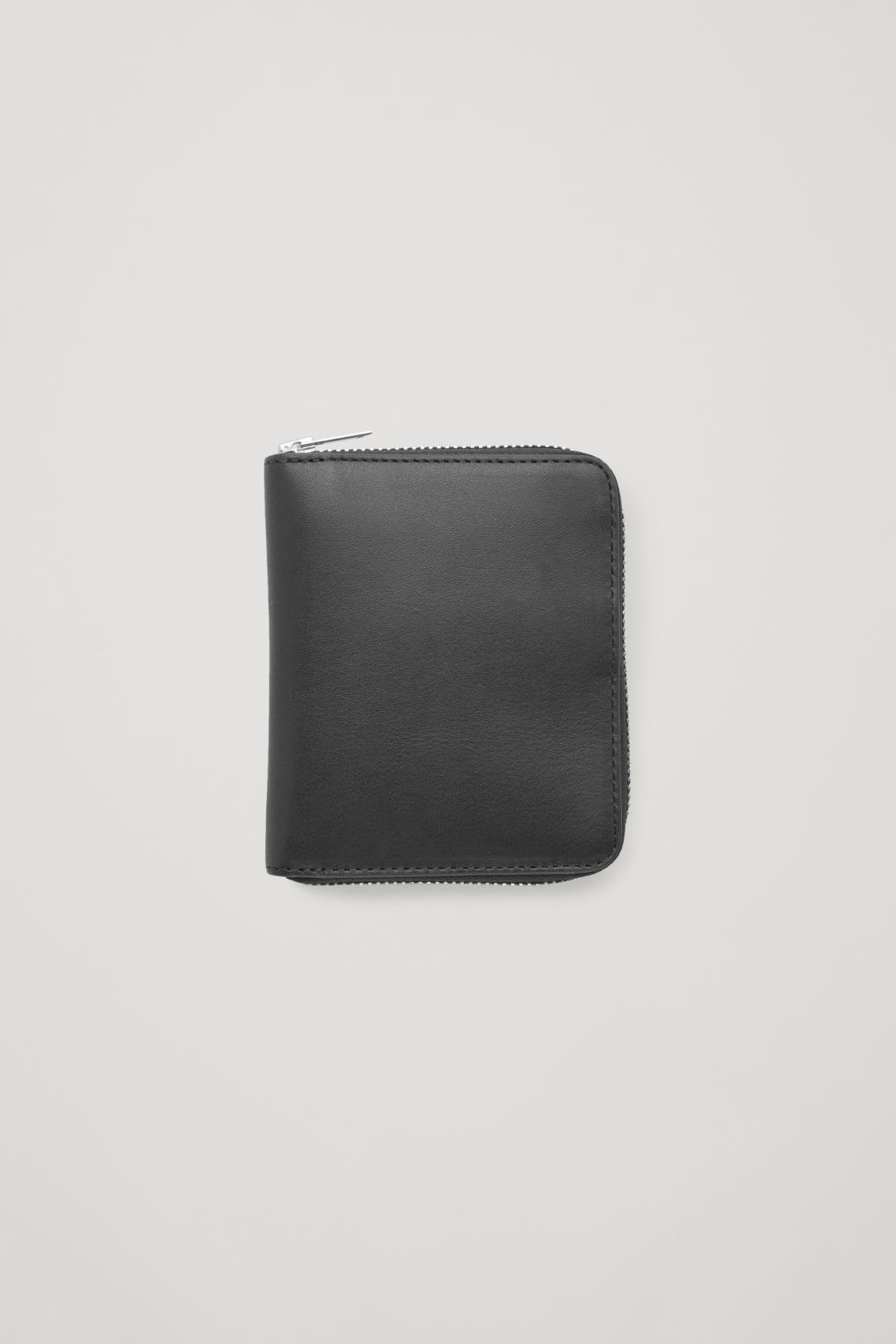 Front image of Cos leather zip wallet in black