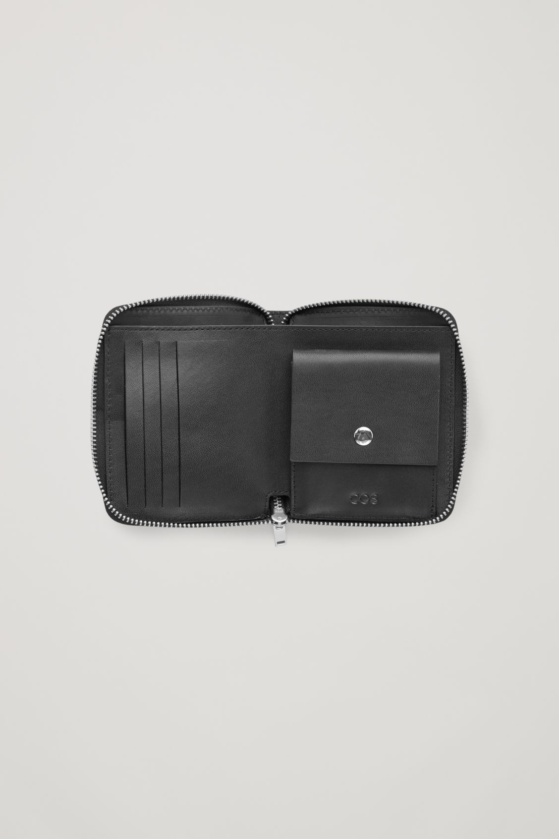 Side image of Cos leather zip wallet in black