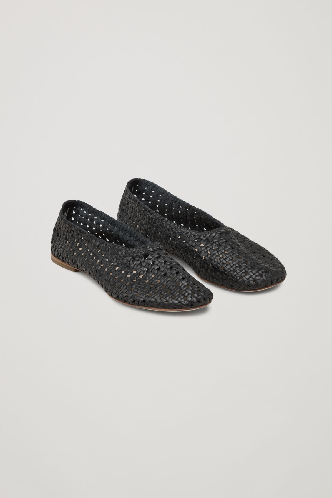 Front image of Cos braided slip-on shoes in black
